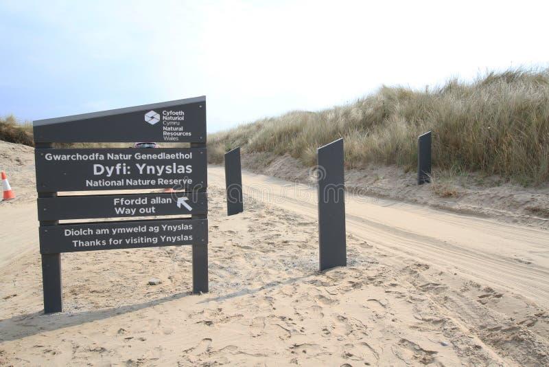 Inträdessymbol för Ynyslas sanddyner royaltyfria foton