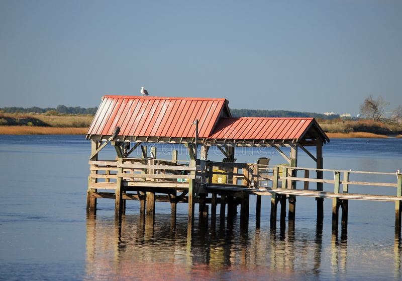 Intracoastal Waterway boat docks on a sunny day. Boat docks along the North Carolina Intracoastal Waterway in Sunset Beach stock photo
