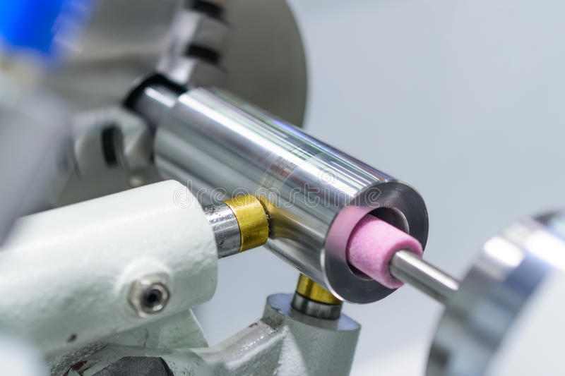 Intragrinding machine during operation. stock photography