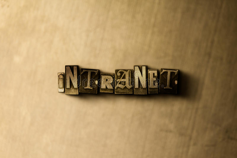 INTRANET - close-up of grungy vintage typeset word on metal backdrop stock images