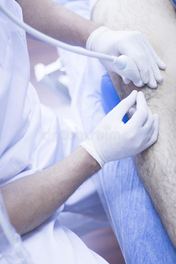 Intratissue percutaneous electrolysis. Ultrasound assisted EPI ecography intratissue percutaneous electrolysis physical therapy rehabilitation physiotherapist royalty free stock photos
