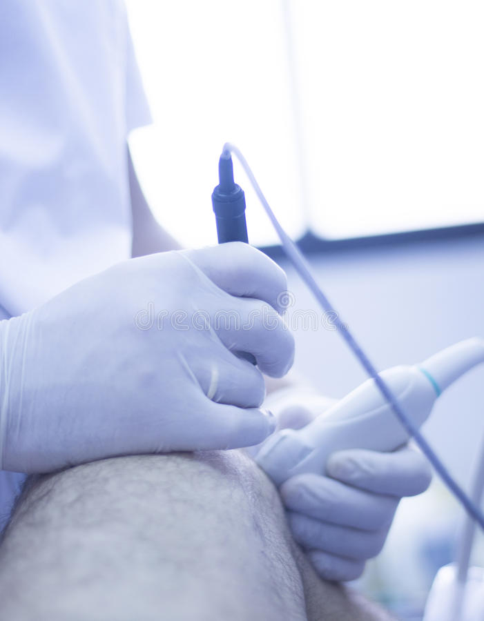 Intratissue percutaneous electrolysis. Ultrasound assisted EPI ecography intratissue percutaneous electrolysis physical therapy rehabilitation physiotherapist royalty free stock photo