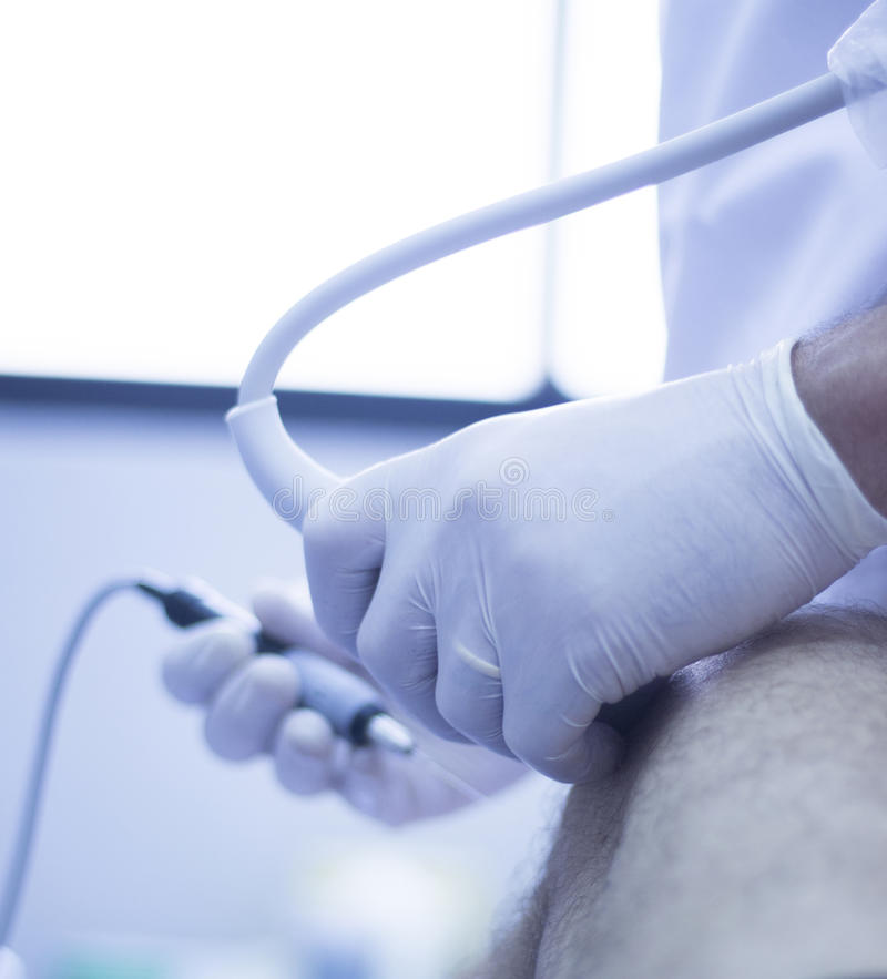 Intratissue percutaneous electrolysis. Ultrasound assisted EPI ecography intratissue percutaneous electrolysis physical therapy rehabilitation physiotherapist stock photo