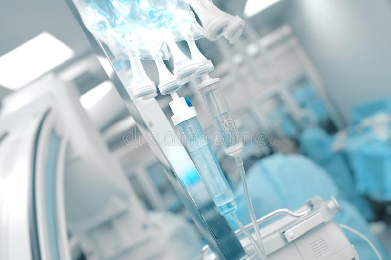 Intravenous drip on the background of working medical doctors te stock photo