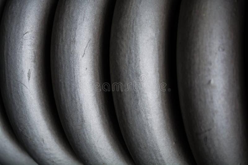 Intrecciatura, spesso grigio di spirale da metallo, per mantenimento degli elementi della costruzione Sorgente Struttura o un fon fotografie stock