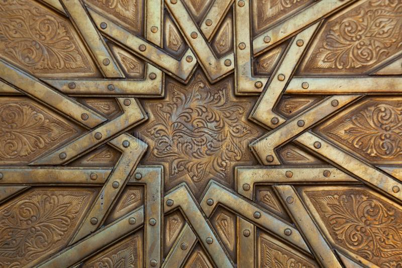 Arabesque on door in Morocco. An intricate arabesque on an carved door in Morocco stock images