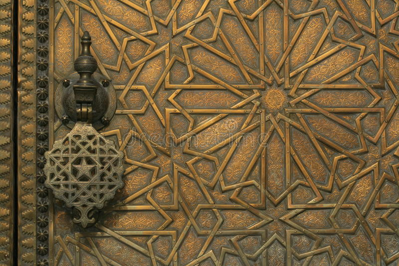 Intricate carved brass door in morocco royalty free stock photo