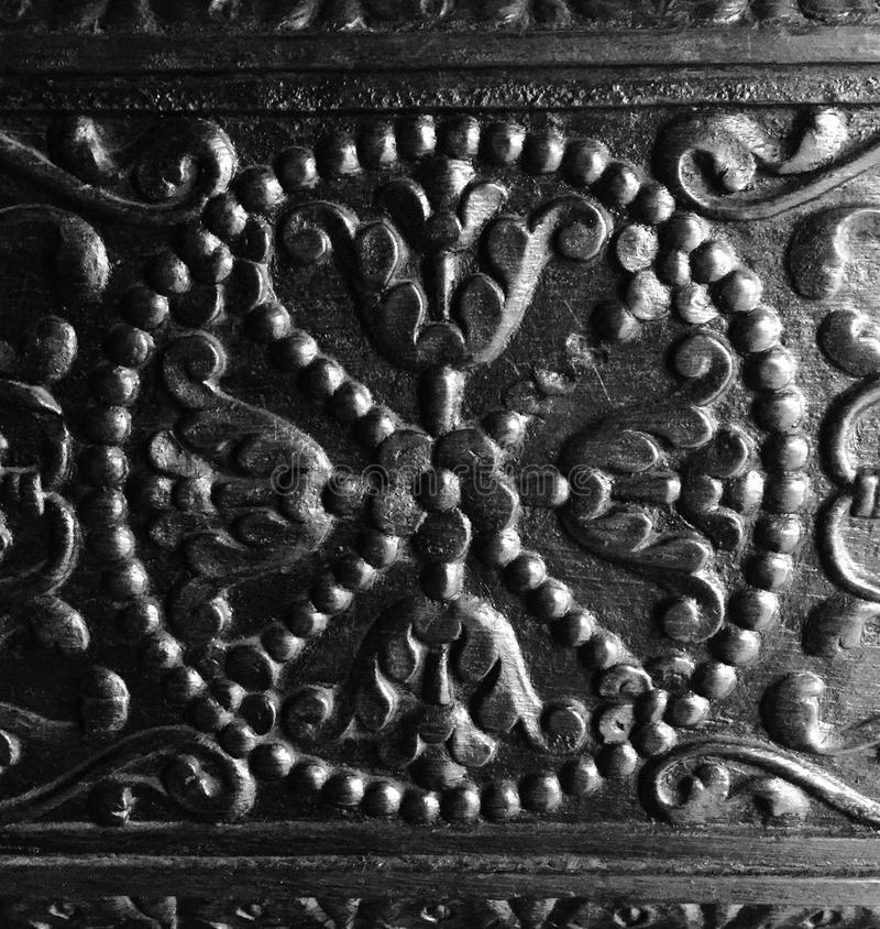 Intricate craftsmanship on antique wood door stock photography