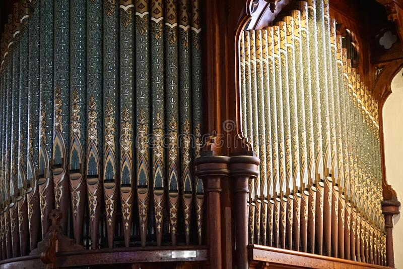 Intricate designs on organ pipes in a church stock image