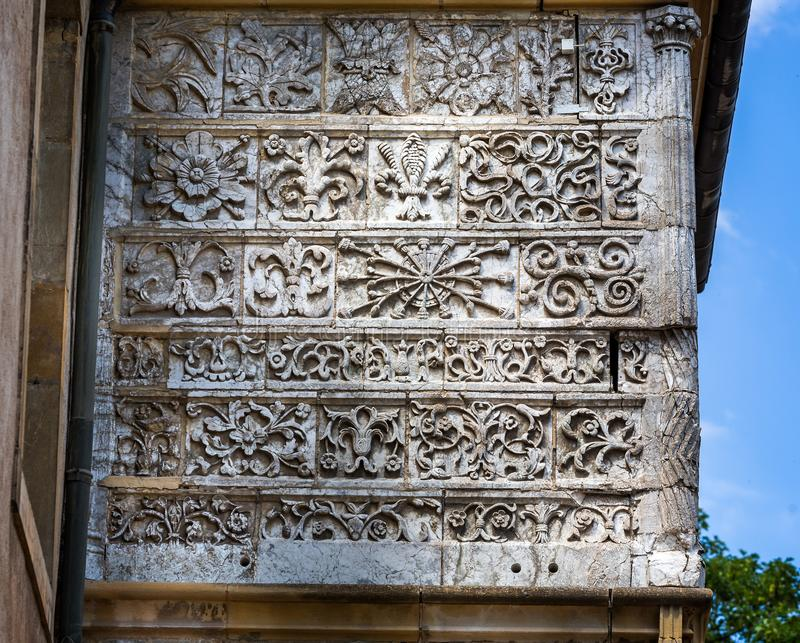 Intricate medieval stone carvings on wall of Mayor`s building in Cluny, France. On 17 June 2015 royalty free stock image