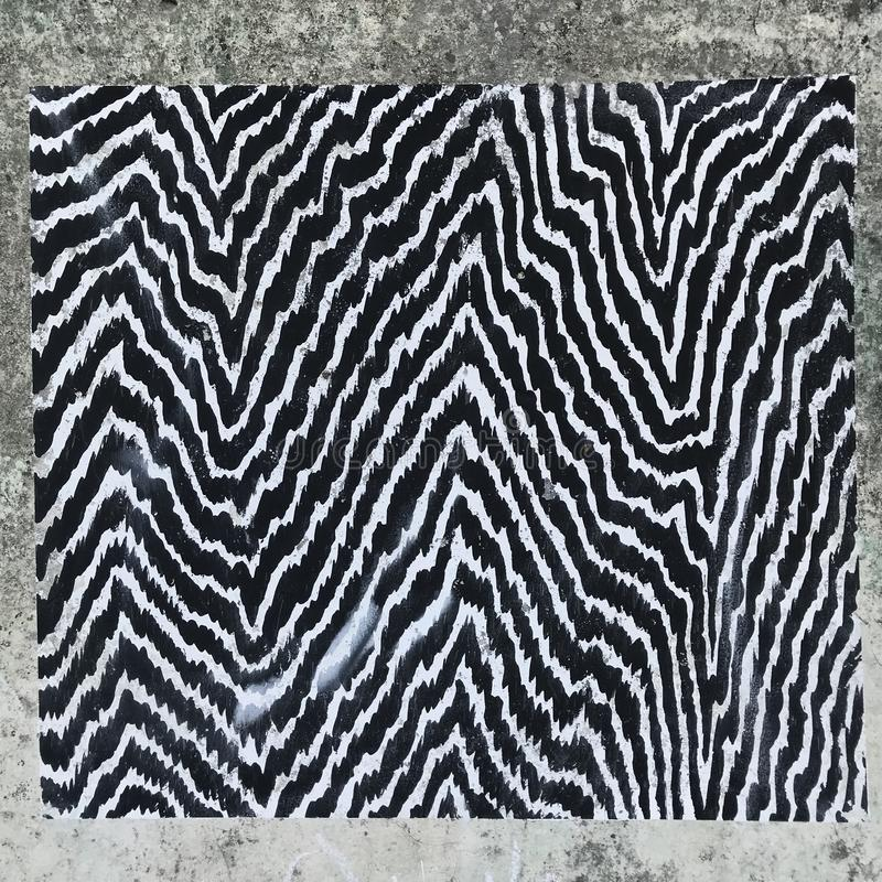 An intricate pattern of black and white zebra lines royalty free stock image