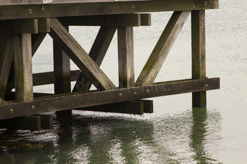 The intricate support beam structure of the viewing platform pier overlooking the Southampton Water at Hythe in Hampshire on the s. The intricate support beam stock image