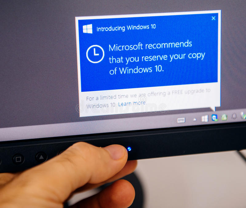 Introducing Windows 10 message on computer display man touching stock photo