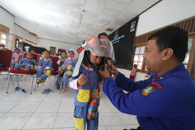 Introduction about the activities of firefighters. Firefighters extinguishing equipment introduced to children in Solo, Java, Indonesia. This activity is to royalty free stock photo