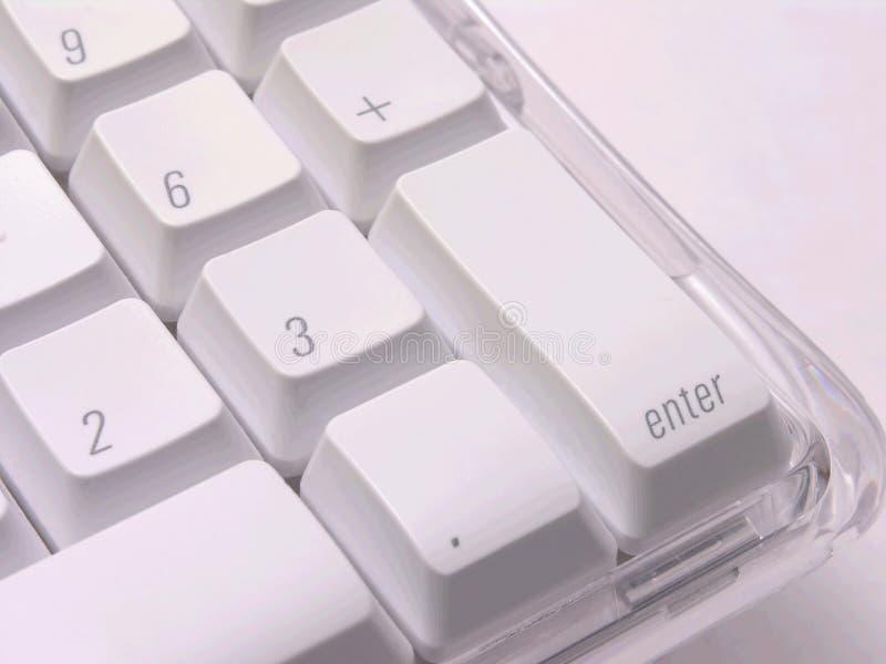 Introduisez la clé sur le clavier photos stock