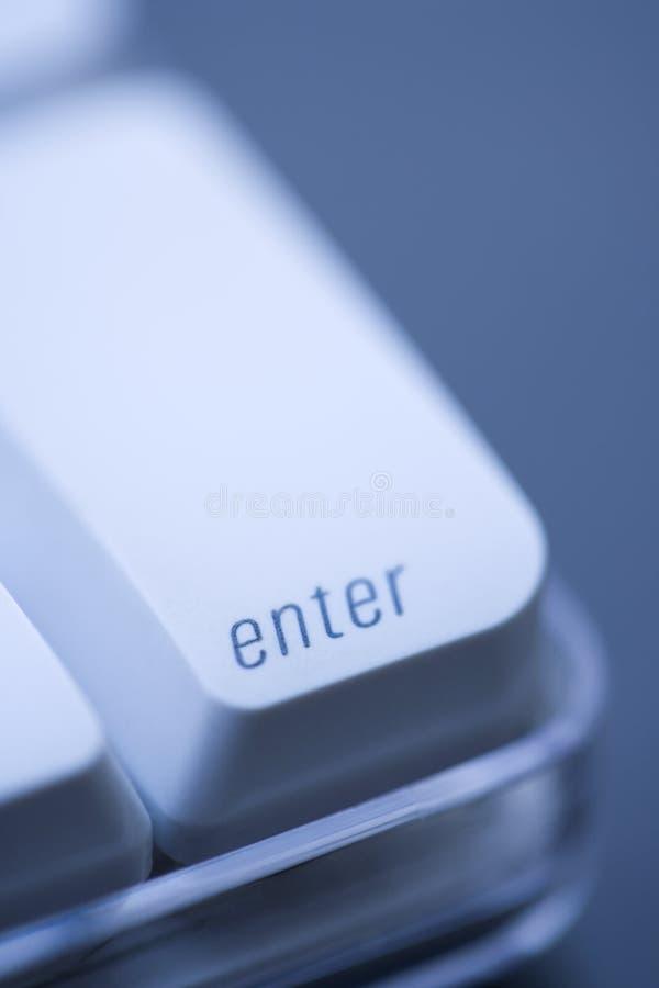 Introduisez la touche d'ordinateur. photos stock