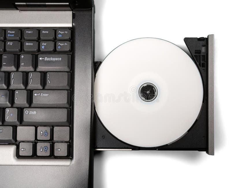 Introduzindo o CD/DVD na movimentação do portátil foto de stock royalty free