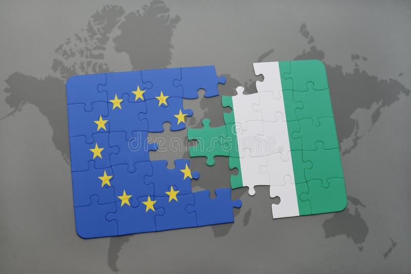 intryguje z flaga państowowa europejski zjednoczenie i Nigeria na światowej mapy tle obraz royalty free