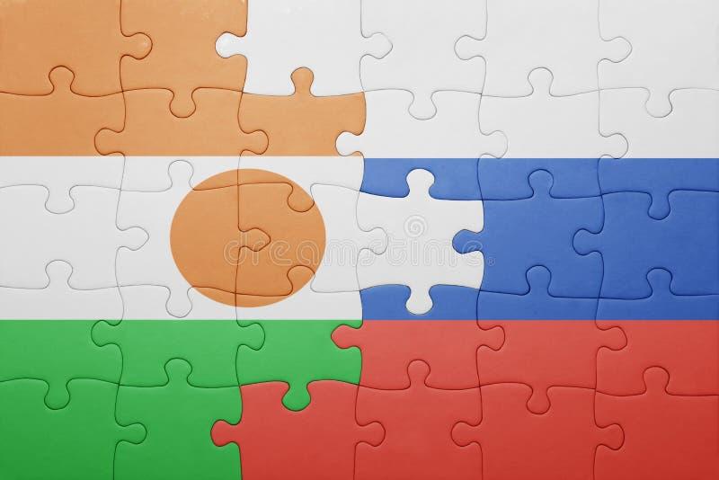 intryguje z flaga państowowa Russia i Niger zdjęcie royalty free