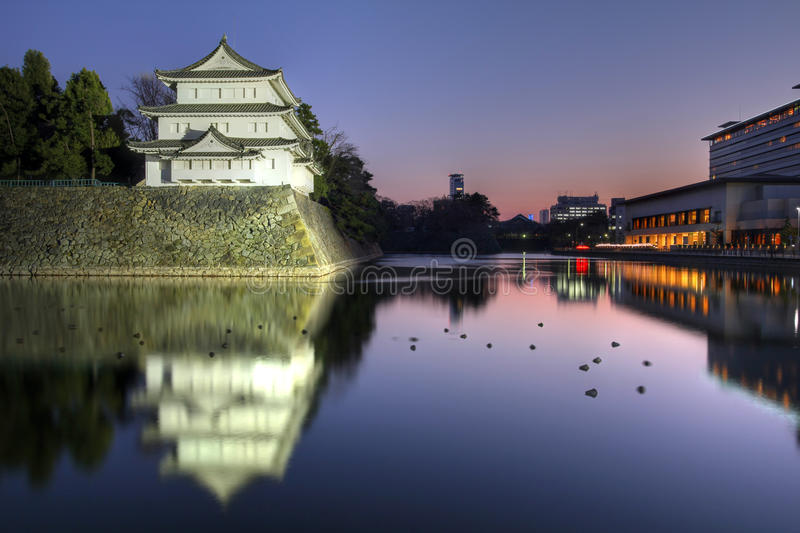 Inui Turret, Nagoya Castle, Japan. Sunset view of the Northwest turret (Inui Turret) of the Nagoya Castle in Japan. The extensive moat is populated by a large royalty free stock photography