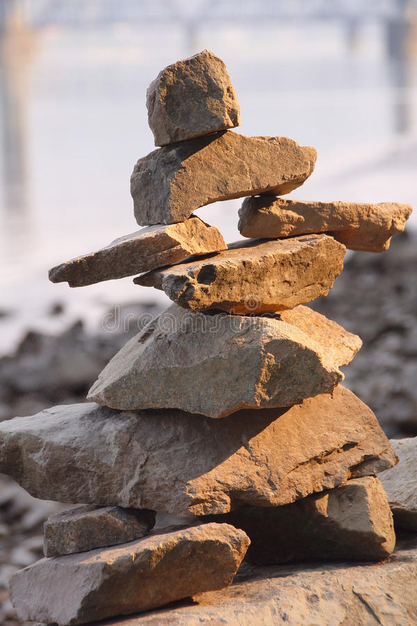 Inuit Inukshuk. A child has created a traditional Canadian Inuit Inukshuk by stacking stones royalty free stock photography