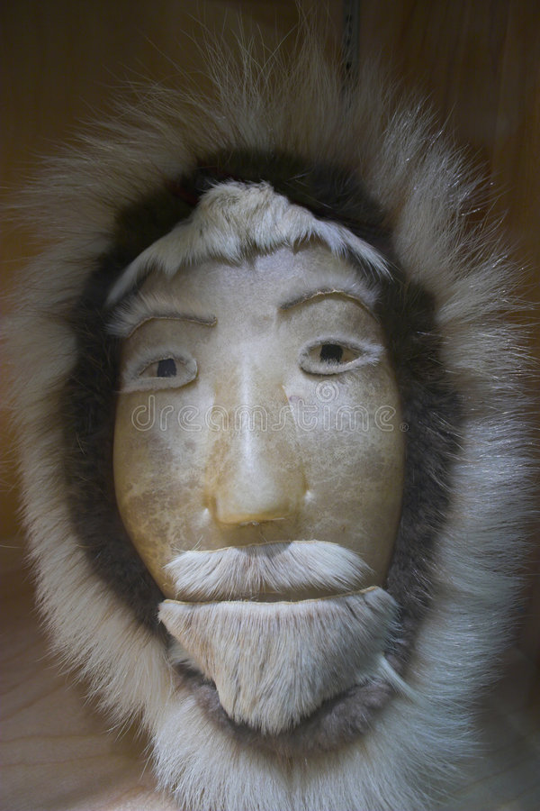 Inuit mask. Traditional eskimo mask made of skin and fur royalty free stock images