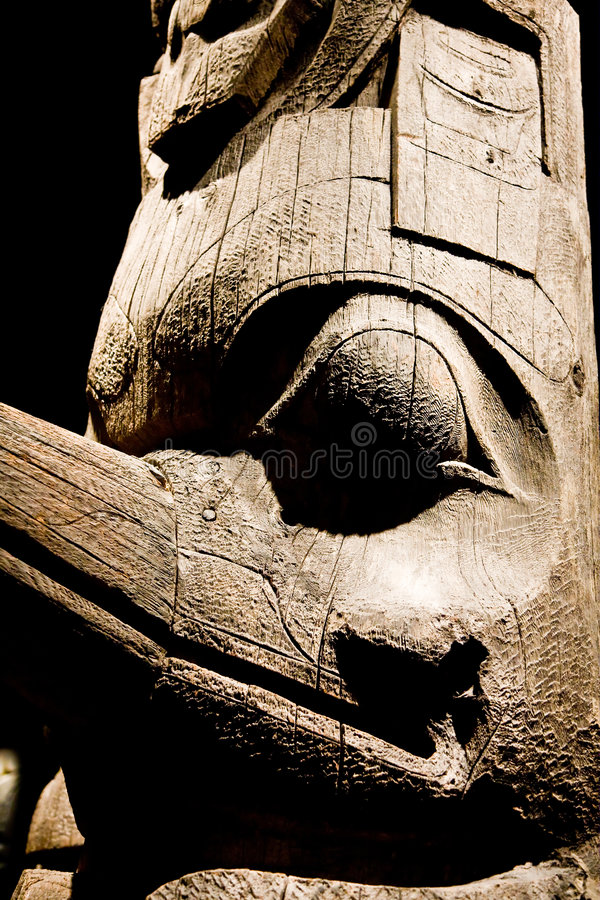 Inuit Totem. An old carved wooden Inuit totem pole royalty free stock images