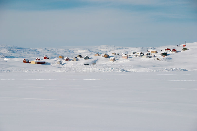 Inuit village. A small inuit village lost in a snowy landscape stock photos