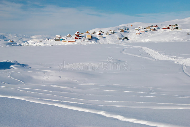 Inuit village. A small inuit village lost in a snowy landscape royalty free stock photo