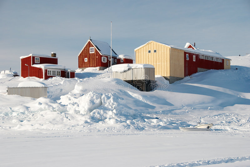 Inuit Village. An inuit village with warehouses in a snowy landscape stock images