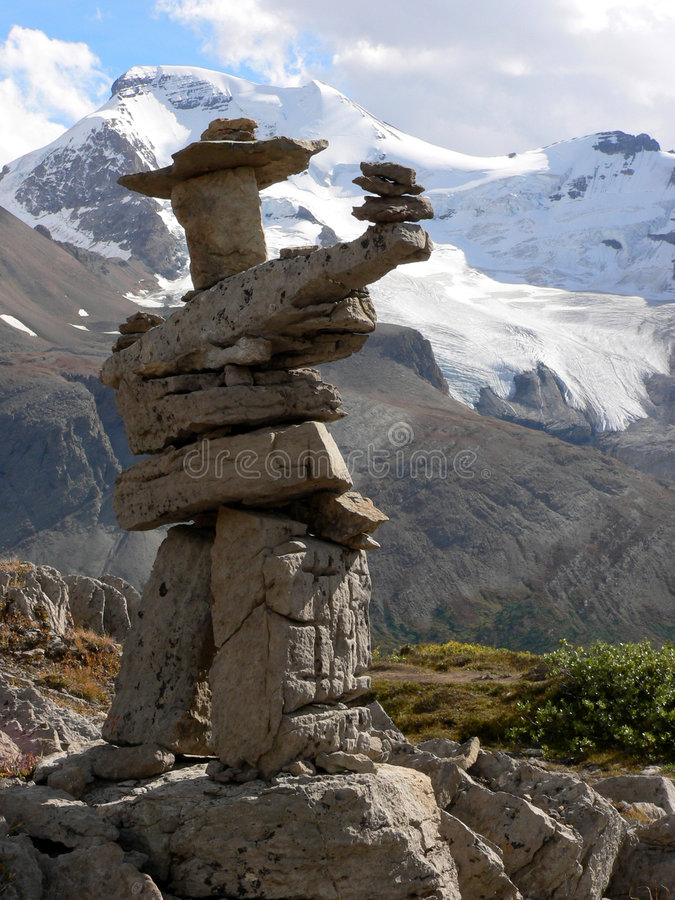 Inukshuk and Glacier. Small Inukshuk with Dome Glacier in background. Near Wilcox Pass, Jasper National Park, Alberta, Canada royalty free stock image