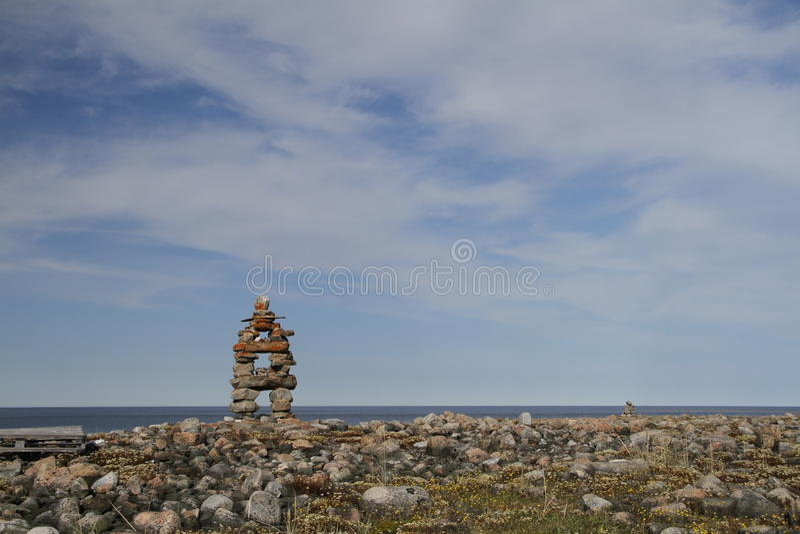 Inukshuk Inuksuk landmark near Arviat, Nunavut. Traditional Inuit landmark near Arviat, Nunavut royalty free stock image