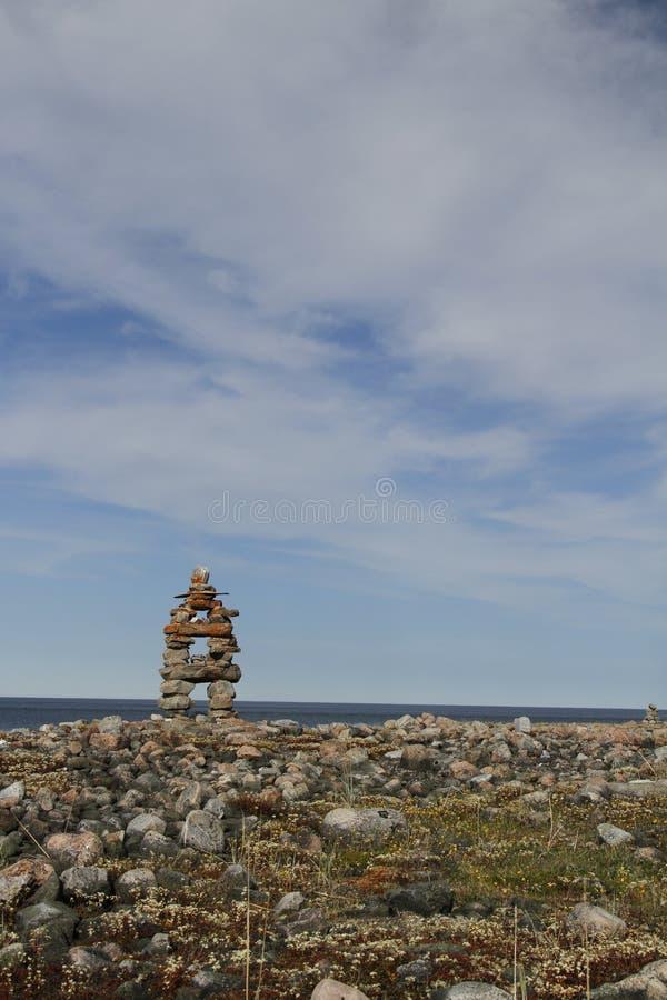 Inukshuk Inuksuk landmark near Arviat, Nunavut. Traditional Inuit landmark near Arviat, Nunavut stock photo