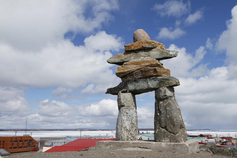 An Inukshuk. An inuksuk, a tradtional monument of the northern Inuit pointing the way in Rankin Inlet stock photography