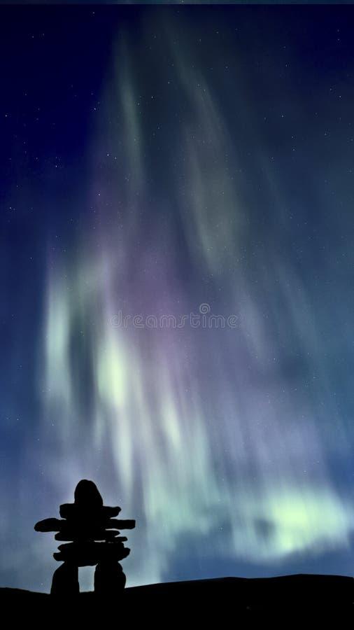 Inukshuk and Northern Lights. Saskatchewan Canada colorful stock photo