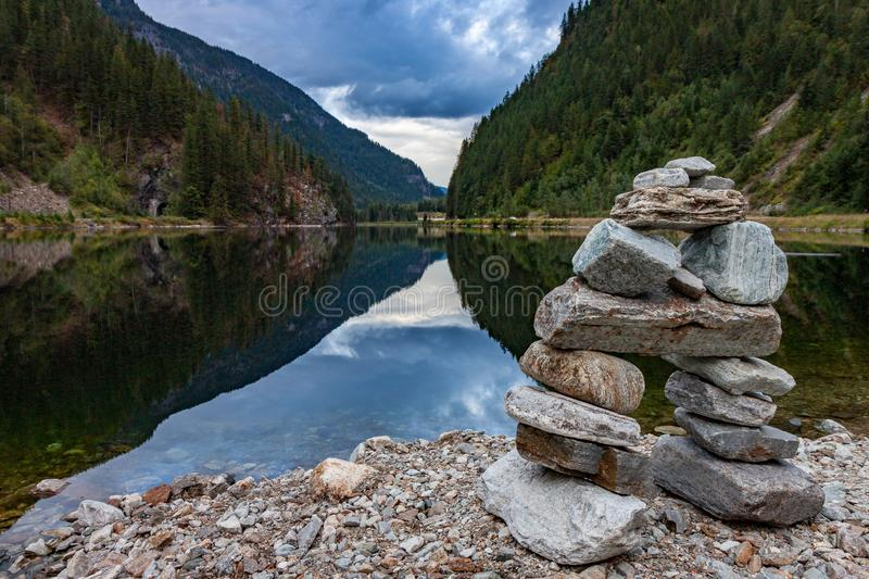 Rock Inukshuk at Griffin Lake British Columbia. An inukshuk overlooks beautiful Griffin Lake in eastern British Columbia stock photo