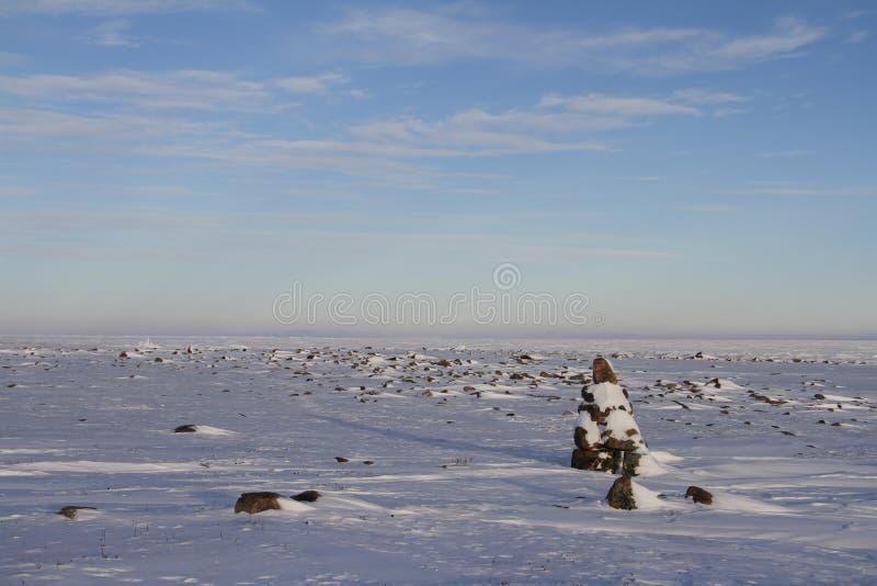 Inuksuk Inukshuk along the coastline north of Arviat. Nunavut royalty free stock images