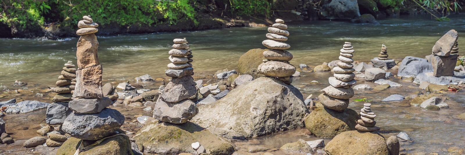 Inuksuk Native Rock Pile in a Creek BANNER, LONG FORMAT. Inuksuk Native Rock Pile in a Creek. BANNER, LONG FORMAT royalty free stock images