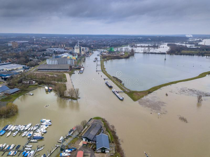 Inundated floodplains near harbor of Wageningen city. Flooded river landscape with submerged floodplains along river Rhine in winter period near harbor of royalty free stock photography