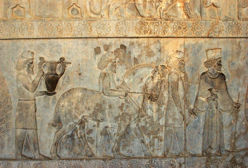 Invånare av historisk välde med djur, Persepolis royaltyfri bild