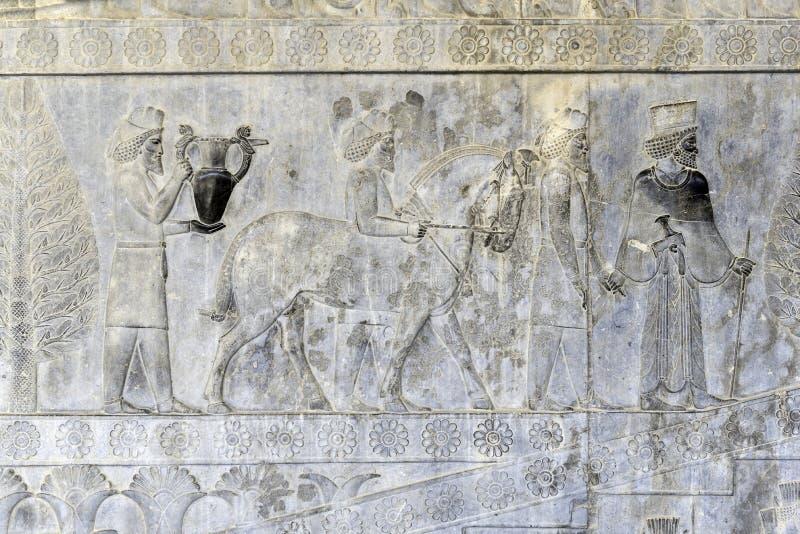 Invånare av historisk välde med djur Persepolis Iran royaltyfri fotografi