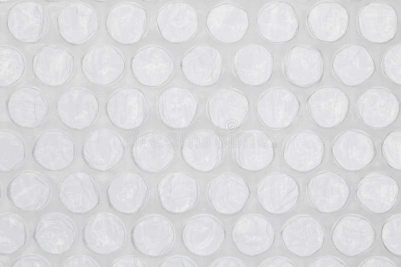 Invólucro com bolhas de ar cinzento fotografia de stock