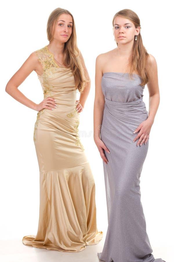 Inveja de seus amigos - duas meninas no vestido imagens de stock