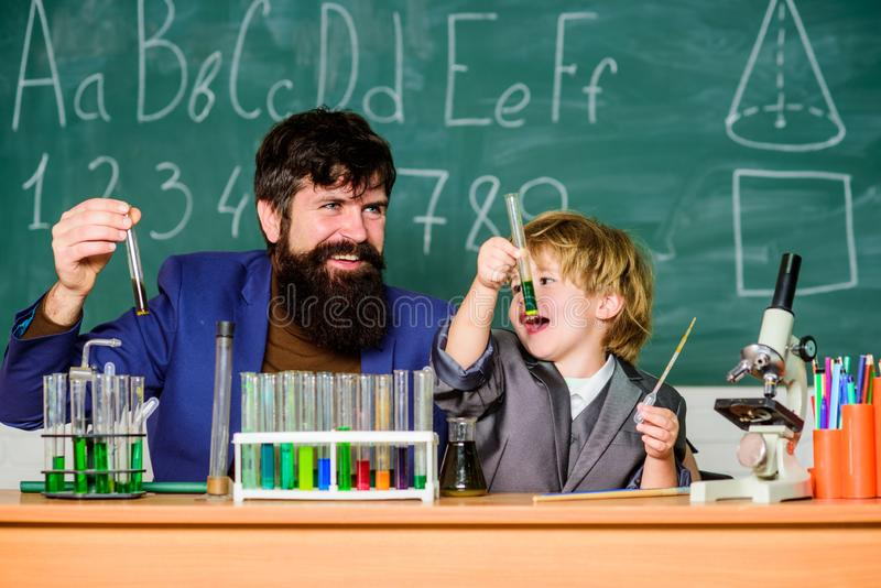 Invent. Chemistry beaker experiment. laboratory research and development. father and son child at school. bearded man stock image