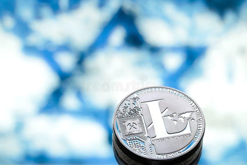 Invente le litecoin, dans la perspective du drapeau israélien, concentré images stock