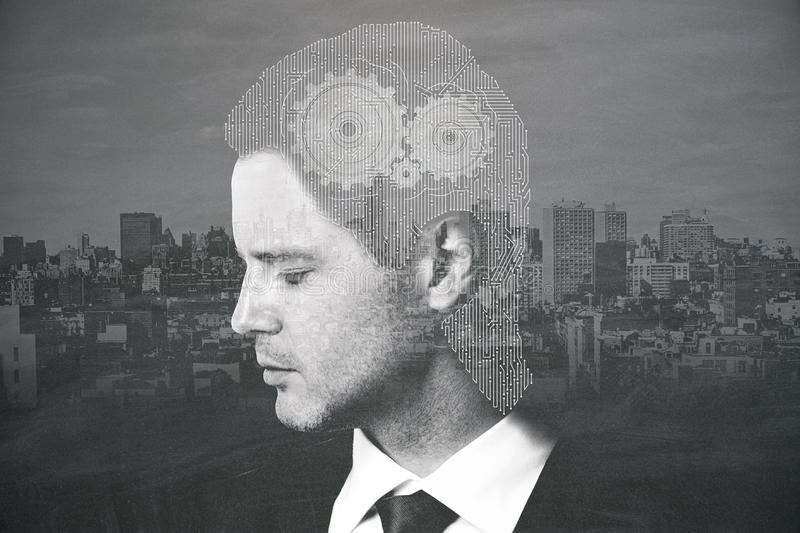 Invention concept. Businessman with abstract mesh head and cogwheels on night city background. Invention concept. Double exposure. Black and white image royalty free stock images