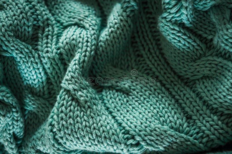 Inverdisca il fondo tricottato di struttura del maglione, maglione sgualcito immagini stock