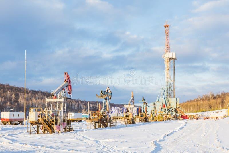 inverno do equipamento de perfuração da terra fotografia de stock
