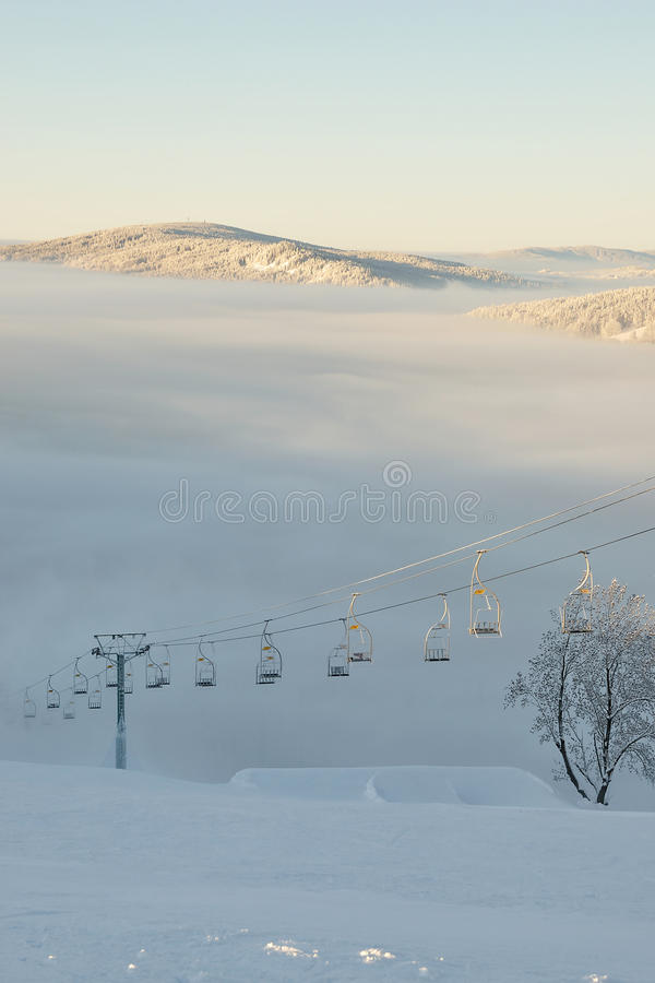 Inversion. Chair lift going in to inversion in a ski resort in the Czech Republic stock photography