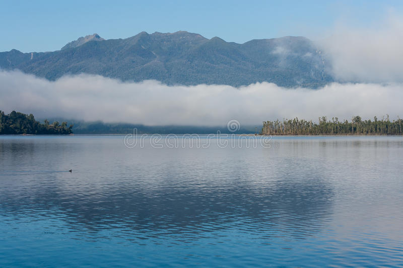 Inversion over lake Brunner. In New Zealand stock photography